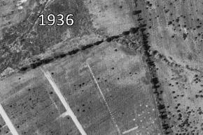 Black and white aerial photograph of the future site of Woodlawn Elementary School, taken circa 1936, just prior to construction of the school. The school grounds and the surrounding area are all farm fields.