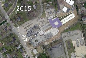 Color aerial photograph of Woodlawn Elementary School taken in 2015. A major renovation is in process. Many of the older sections of the building have been torn down or are in the process of being torn down. Mobile classrooms cover the formerly open playground areas.